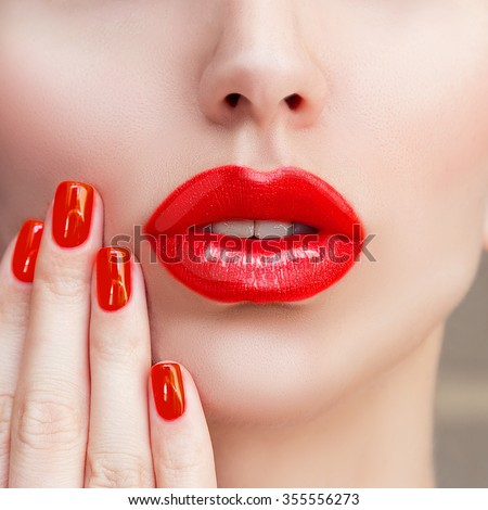 Red Sexy Lips and Nails closeup. Open Mouth. Manicure and Makeup. Make up concept. Kiss. Red Lipstick, lipgloss  - stock photo