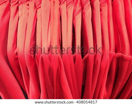 Red Shirts hanging on a clothesline. - stock photo