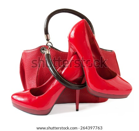 Red shoes and bag isolated on white background - stock photo