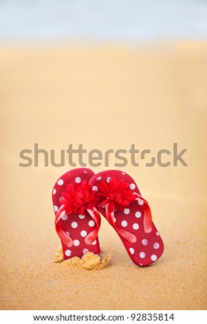 red shoes on the sand - stock photo