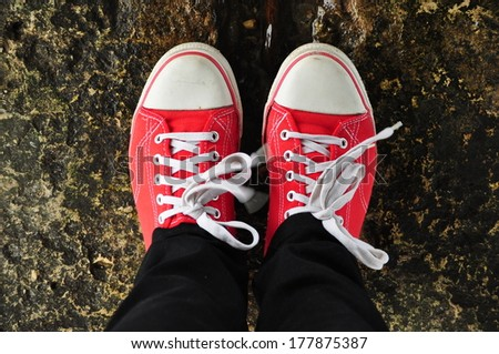 Red shoes with white laces - stock photo