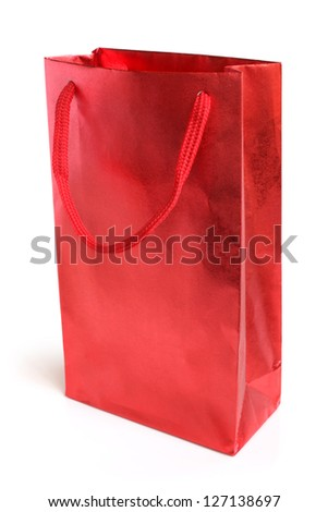 Red shopping paper bag on a white background - stock photo