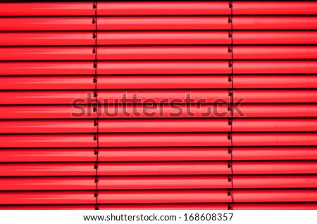 Red shutter blind in a house window - stock photo