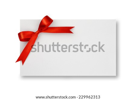 Red silk bow on empty paper card isolated on white background  - stock photo