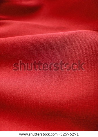 Red silk, satin fabric. For Christmas, valentines, bedroom, bed sheet, bed linens, fashion, abstract, romantic, drapery, sexy textile background design. More of this motif & more textiles in my port - stock photo
