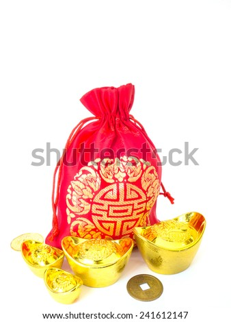 Red silky money bag with ancient Chinese golden ingots and coin : lucky pouch - stock photo