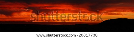 Red skies at sunrise at Salton Sea - stock photo