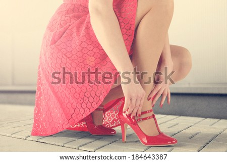 red skirt and legs  - stock photo