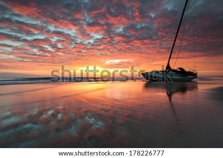 Red Sky Sailor's Warning Shipwreck Outer Banks Cape Hatteras National Seashore Sunrise North Carolina - stock photo