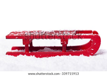 Red sled with snow isolated on white background - stock photo