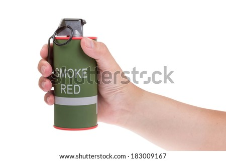 Red smoke grenade in hand isolated on white - stock photo