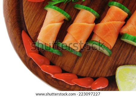 red smoked salmon slices with vegetables and lemon - stock photo
