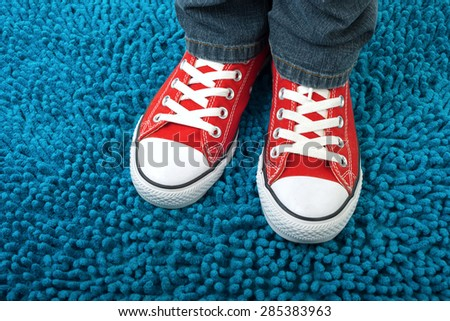 red sneakers fashion on a blue background, urban style - stock photo