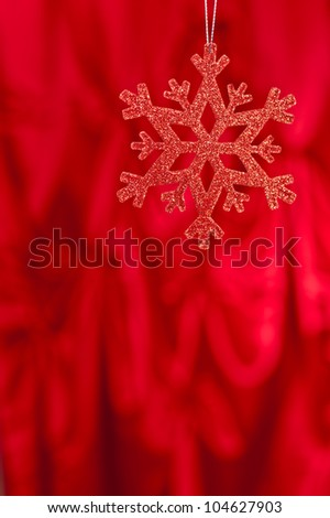 Red snow flake on a red background for Christmas - stock photo