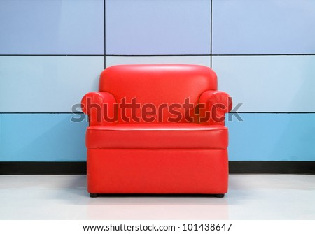 Red sofa and modern wall - stock photo