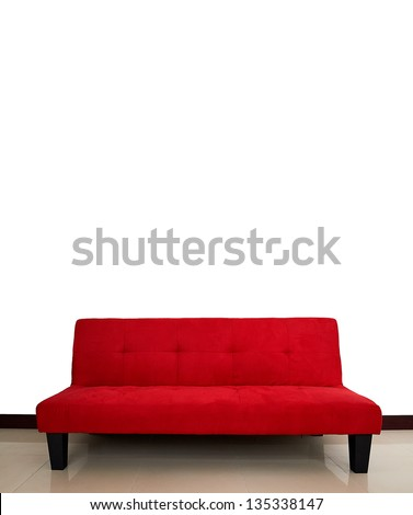 Red sofa in empty living room - stock photo