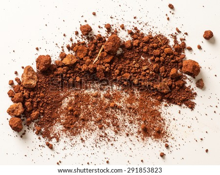 Red Soil isolated on White Background. Pile of Dirt and Stones. Top View of a Heap of Ground. Close Up Macro View  - stock photo