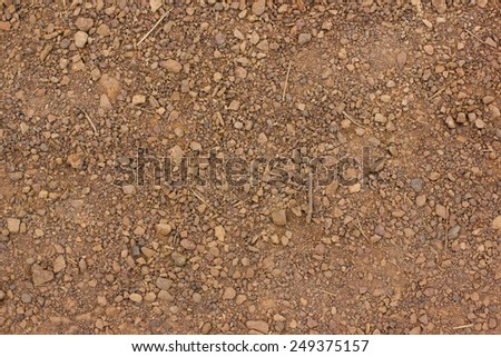 Red soil texture background, dried clay surface - stock photo