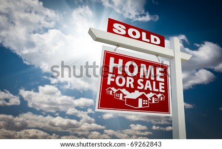 Red Sold Home For Sale Real Estate Sign Over Beautiful Clouds and Blue Sky. - stock photo