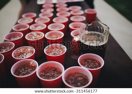 Red Solo Cups Lined Up With Iced Tea - stock photo