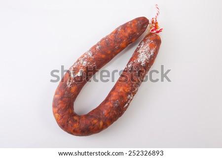 Red spanish chorizo sausage. Isolated over white background - stock photo