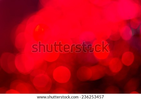 Red special occasions background. Abstract with bright twinkles, sparkles, blurred, defocused light. - stock photo