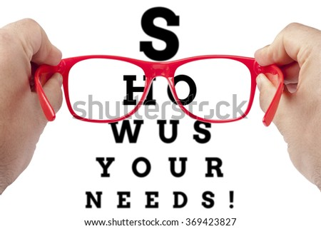 Red spectacles focusing on text Show us your needs arranged as eye chart test - stock photo
