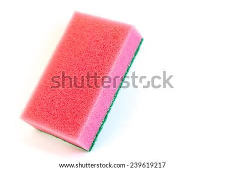 Red sponge isolated on white. - stock photo