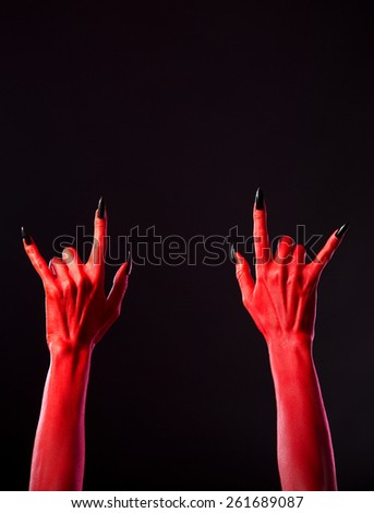 Red spooky hands showing heavy metal gesture, Halloween theme, copy-space for your text  - stock photo