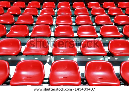 red sport stadium seats - stock photo