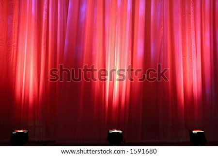Red Spot Lights on Curtain - stock photo