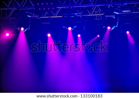 Red spotlights on empty stage - stock photo