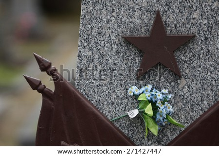 Red star at the Soviet War Memorial with graves of Soviet soldiers fallen in the last days of World War II at the Olsany Cemetery in Prague, Czech Republic. - stock photo