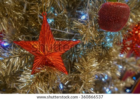 Red star decoration on christmas tree - stock photo