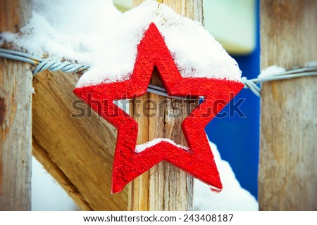 Red star in winter on a garden fence - stock photo