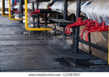 red steam pipes - stock photo