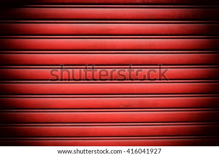 Red steel door with horizontal lines background. - stock photo