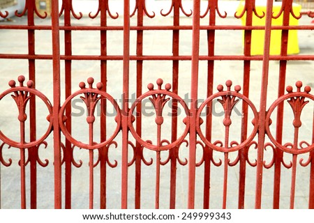 Red steel fence in temple - stock photo