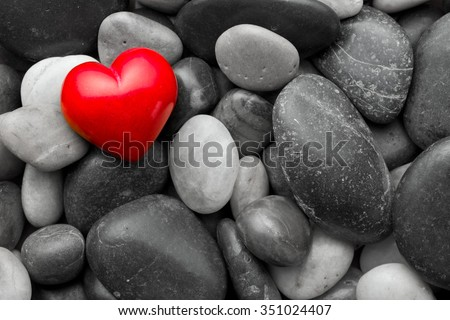 red stone heart on other stones - stock photo