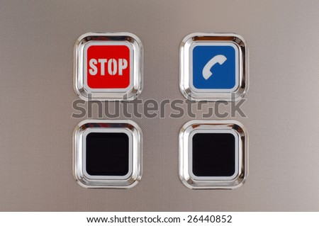 red stop button on the metal surface - stock photo