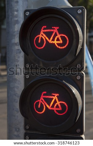 Red Stop Cycle Traffic Light in Urban Setting - stock photo