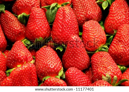 Red strawberries and green leafs - stock photo
