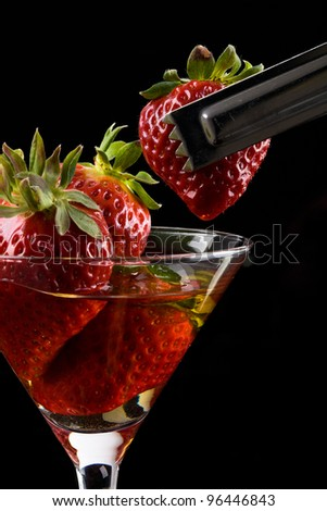 red strawberry cocktail glass, alcohol - stock photo