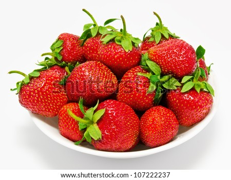 Red strawberry in the bowl closeup isolated - stock photo