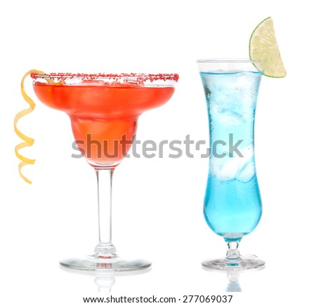 Red Strawberry or raspberry margarita cocktails in chilled salt rimmed glass with tequila orange syrup lemon spiral and blue hawaiian crushed ice in cocktail glass on white background - stock photo