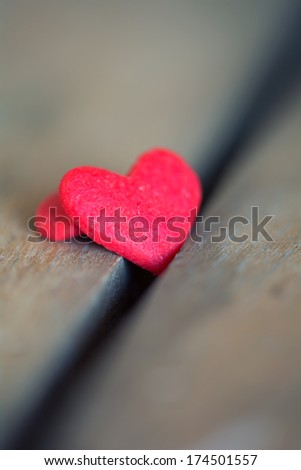 Red sugar heart with very shallow depth of field. - stock photo