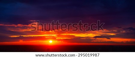 Red summer sunset sky panorama. Dark vibrant colors. - stock photo