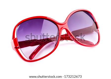 Red sunglasses on isolated white background - stock photo