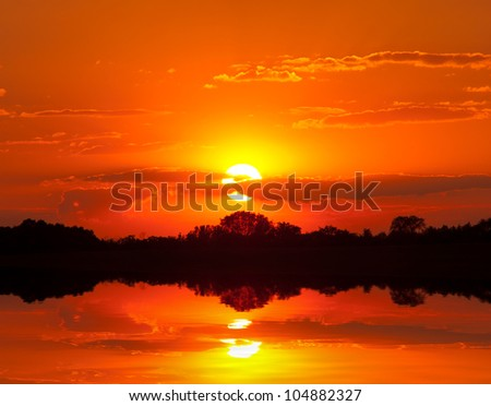 red sunset over lake - stock photo