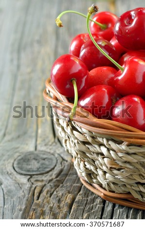 red sweet cherries in a  basket - stock photo